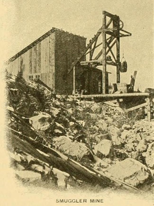 This is an early view of a small mine operation that turned into a much larger mine. But here it is a good example of a small head frame and hoist house more or less built together, but still with the shaft out in the open air. Perfect for a mine model.
