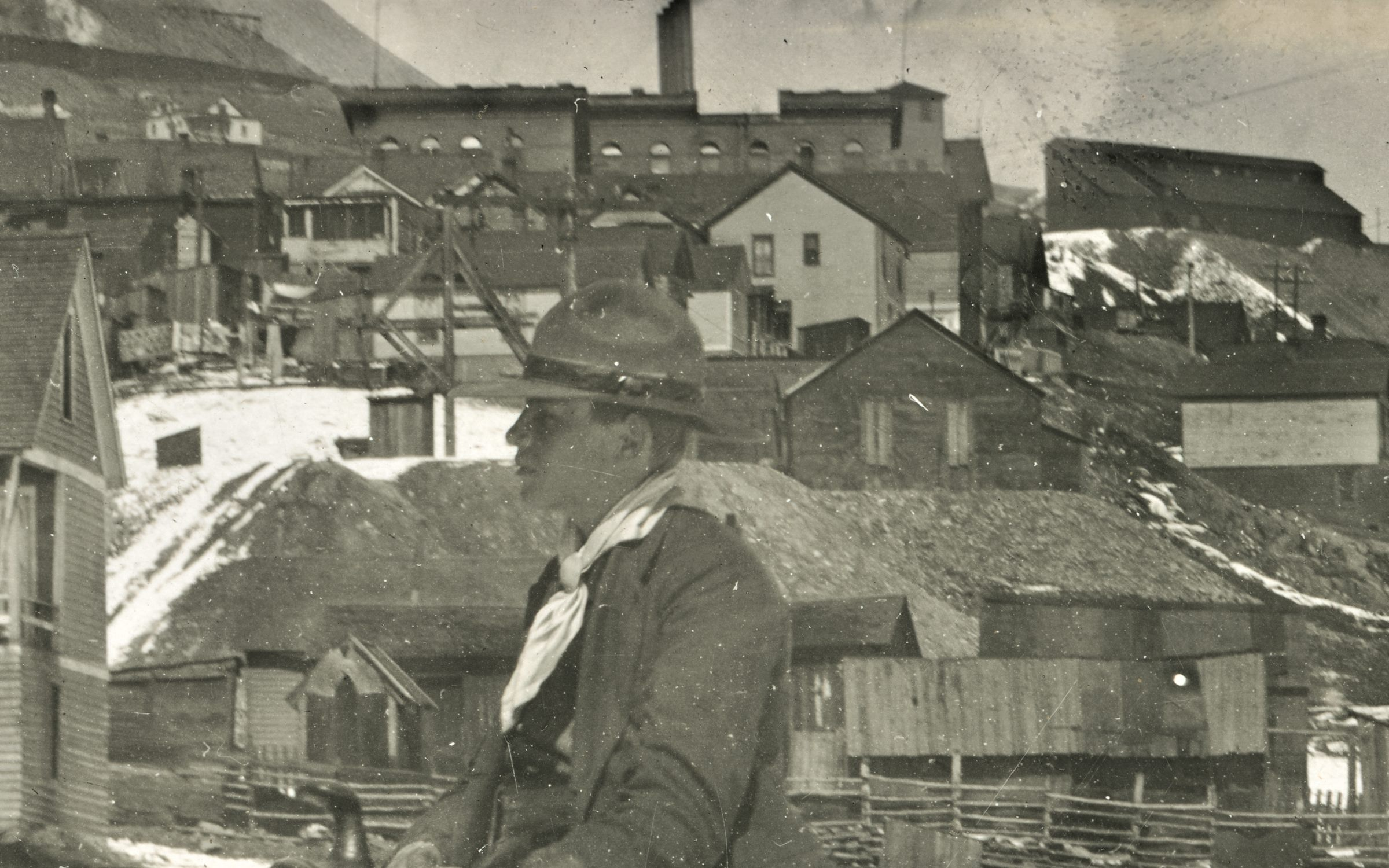 I think this image is at the eastern end of Spicer Avenue, and that the mine seen with its Head-Frame behind the head of the rider in the foreground is the Fortuna Mine, but I might be off as this been hard to decode fully where it was photographed, it might be even further south in Victor.    In background top right, about 1/4 down from top and covering about first 1/4 in from right-hand side there is seen the Ore-House of the Independence Mine. Also, about center sideways and about 1/5 down top is the brick structure of the Victor High School seen blocking most of the view to the Shaft House of the Independence Mine.    At the top left corner there is seen the massive dumps of the Portland Mines and part of the Crib-wall below the No. 2 Shaft is seen, so yes, the mines really set their feel on town.