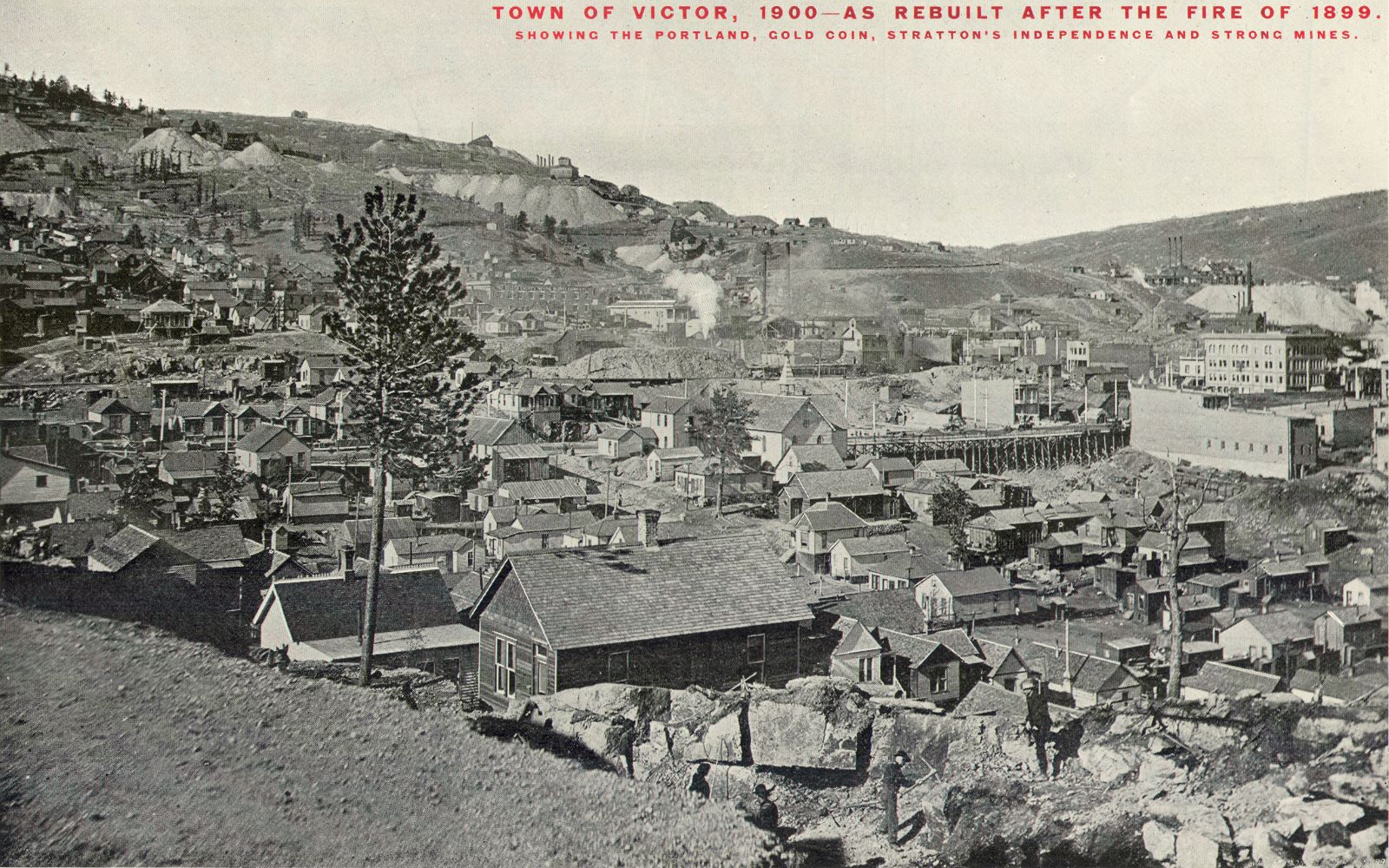 This view is taken near the point on the southwest of Victor where the Low Line entered town and where it had its upper curve before going downhill along 7th street and then entering through another curve into Victor Avenue. The first, upper, curve should just be behind the photographer I think. There are a lot of small houses visible, the Gold Coin ore house and mine is visible near middle of image, off to the right half of this view. It's a little hard to make out details, but the full extent of the most common known Gold Coin with its bricks is not there yet. Battle Mountain and its mines, like the Portland Mine is visible behind the town, while the Strong Mine and the Independence Mine mark the right edge of the picture.