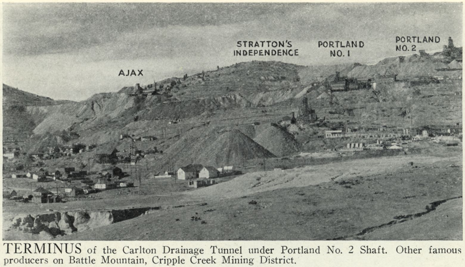 This is an overview of some of the famous mines, making Victor, Colorado, ''The City of Mines''.    Battle Mountain where some of the mines are nicely marked out. The strong Mine is seen just below middle top/down and just left of the Word ''AJAX'' on the left side of this view. The Independence is see sort of in the foreground with massive dump piles extending towards the photographer, while the Portland mines dumps fill the upper part of Battle Mountain on the top right part of the view.    Town of Victor is partly seen in lower left, while the Ajax Mine is nicely marked out but still hiding behind some pretty massive big dumps on the upper left part of this view.