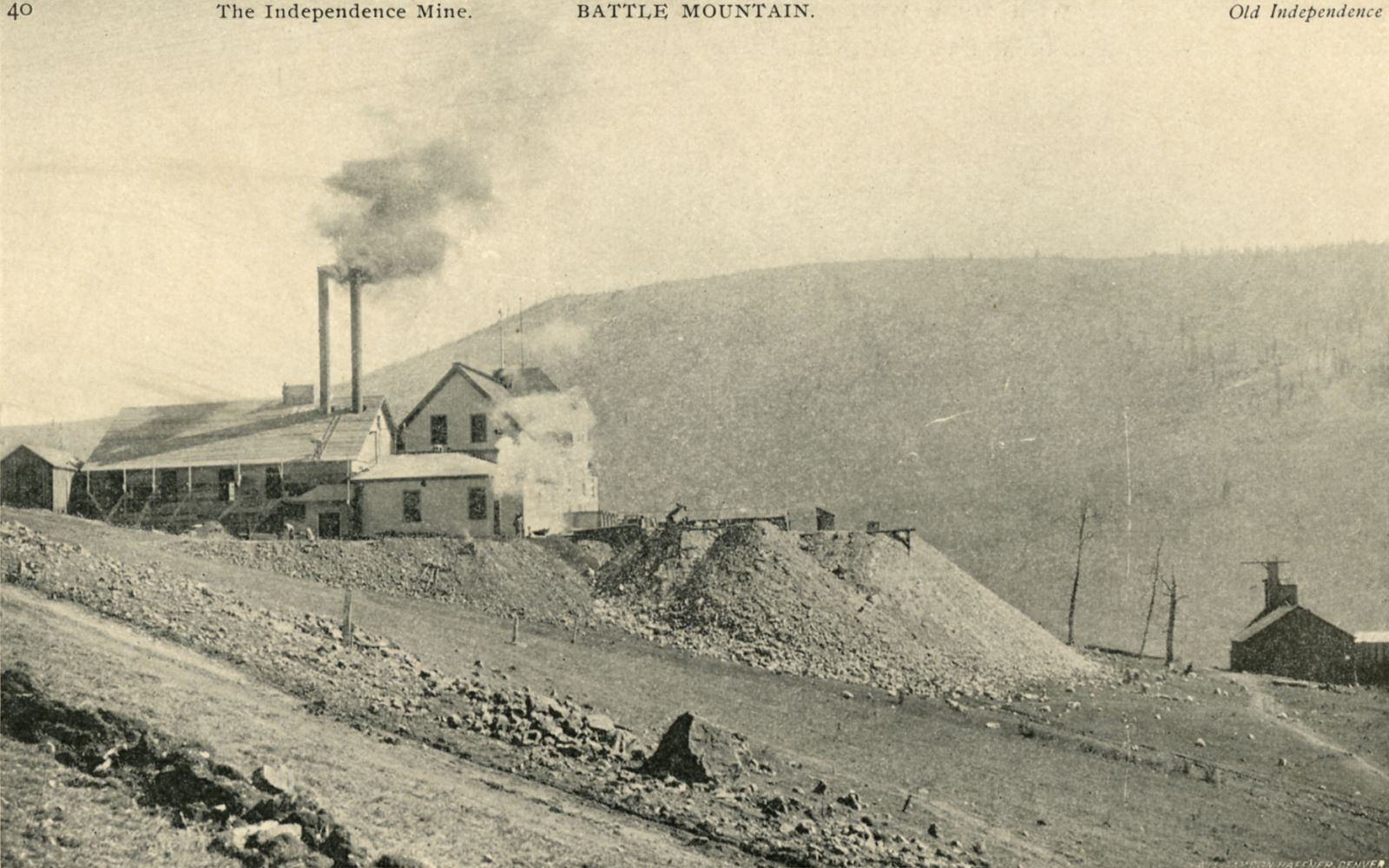 This view looking in direction of east is showing the large surface structures of the Independence Mine (No. 1 shaft) on the left-hand side and the smaller original shaft house and ore-bin of the Old Independence Mine on the right-hand side, ore-house is only partly seen, being cut off in the view from the 1896 book, while the DPL view has some more of it. In just a year or so this scene would have changed very and the old shaft house will be gone forever and in that location a small mill – at first – shall be erected, and later a large ore-house and mill will fill that space and also further east and north.