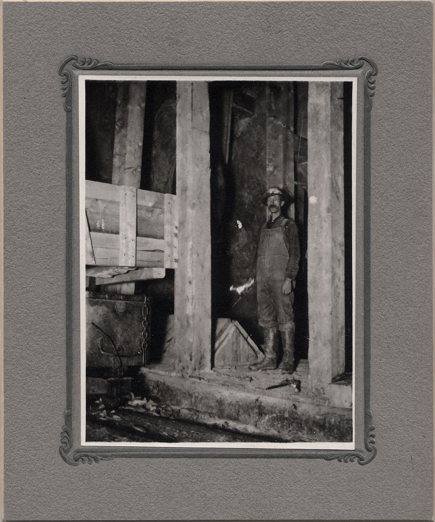 According to info from Steve Rush this is underground at the Gold Coin mine, and this photo came through him to me, from his late friend George Foott. It shows a miner underground at one of the levels in the mine, but all info I have is that it came from a family in Victor whose father worked at the Gold Coin. Not marked on backside or anything so it can possible be anywhere.