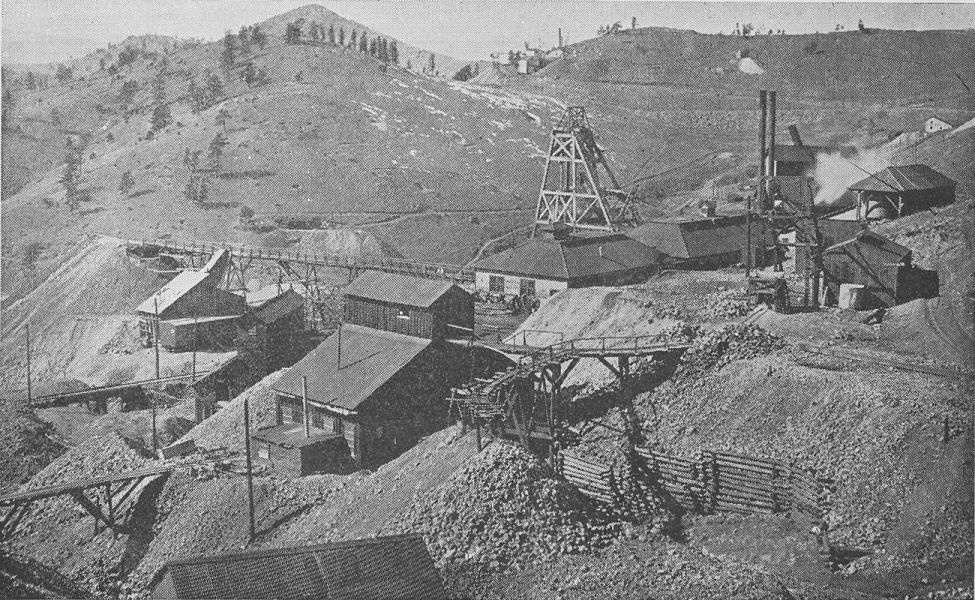 This view is showing the Morning Glory mine up close. Marked Doctor-Jack Pot Estate in a copy I have from an unknown printed source (as per 07.01.2017) where text visible mention 1904 and eleven years ago, making this issue a 1911 one – hence the date on this view must precede that year. I was extra please the day I found this view also on the PPLD site, making it way better to get a good look at the mines in the background.    Middle top you see the orehouse and hoist house of the Index Mine, while the small shaft house of the Union Bell is seen about half width towards the right-hand side, with the side spur to the Index seen below the mines, and he railroad fill belonging to the Low Line sort of cutting through the upper part of the Morning Glory smokestacks.