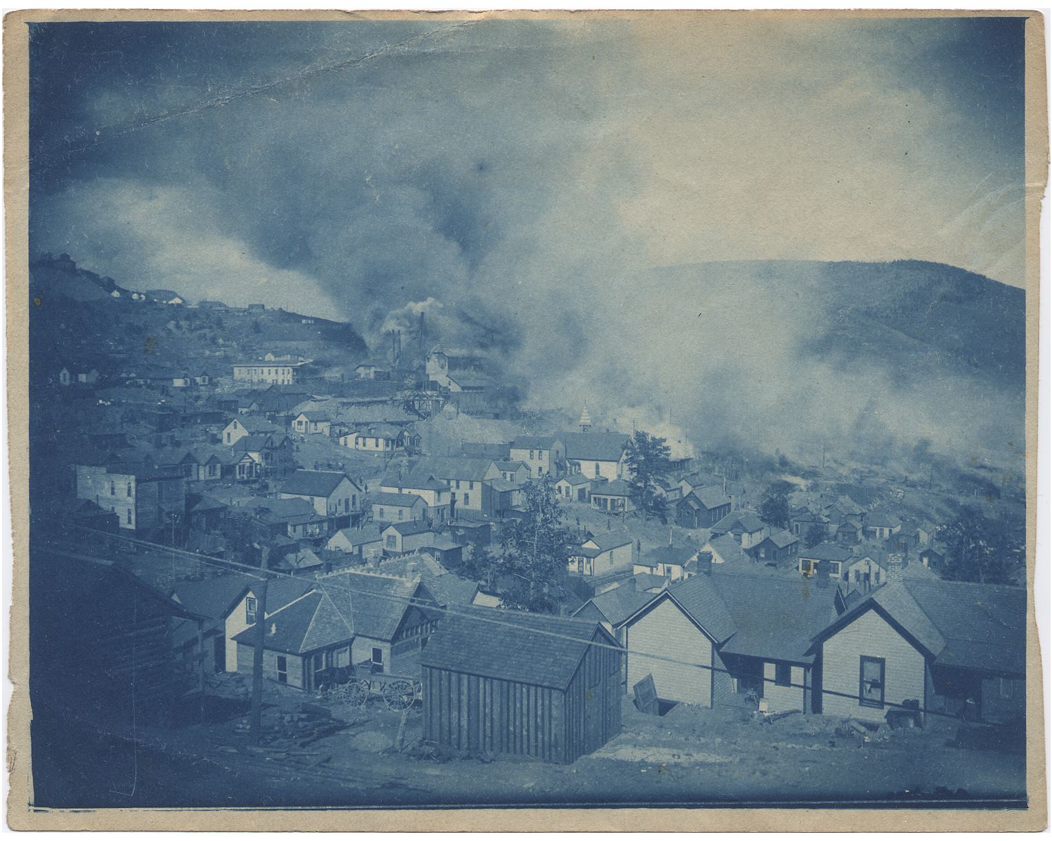 Yet another view of the Victor fire as seen from someplace along the 7th street, looking sort of northeast towards the burning town and the burning Gold Coin mine, this fateful Monday in August of 1899! The paper quality leaves much to desire, but for someone, this was a memory to hold on to and hundred or so years later it founds it way to me here in Norway.