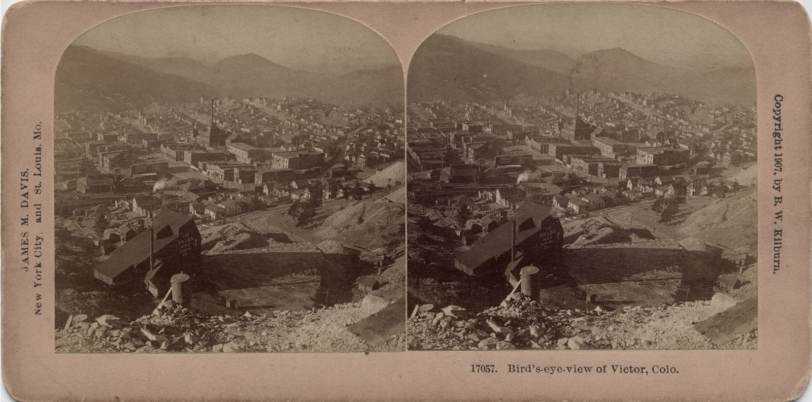 I have assumed as this stereoview is copyrighted by a person that this is also the photographer, and that the year is the year the photo was taken, but I might be dead wrong here. Either way, this is sadly not the best quality view I've seen, the paper the photo's making up this stereoview is processed on, did not do justice to the view I feel, making it un-sharp and hard to see details on. In the foreground left bottom is either way the reason I had to get this view in the first place, the shaft house of the Dillon mine! With its odd shaped roof part where it is very steep on the right-hand side and way less steep on the other side, it makes an interesting building to model (one day). The Mary Cashen ore-house is seen near the left-hand side, about middle top/bottom. The Gold Coin Mine is a little above the center of the view, in this view it has a sort of steep pyramidic shape almost, but sadly very hard to see any details and not really any good presentation of it. The dump of the Dead Pine can be seen about middle top/bottom on the right-hand side, more on the left view then the right view, but no structures are seen, hence it really doesn't fit to be linked to that mine.