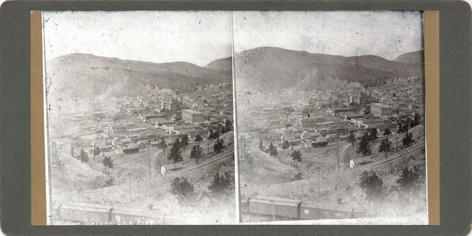 Sadly, this image has seen way better days, and what is presented here is the best I could get out of the very faded view of Victor, photographed sometime before the 1899 fire that wrecked the town. As there is a Trolley car about middle of view from side to side and about 1/3 up from bottom, this view is most likely from 1898 or no later than 1899, as while the trolley line had its grade done to Victor, inclusive rails & catenary by December 1, 1897, regular service was not started before January 3, 1898. The railroad in the foreground is the M.T. mainline with a string of boxcars set out on a siding, going towards the Monument mine, but not sure if it ever was connected to the mine. * The head frame seen on left-hand side, near bottom, is most likely the Dillon mine. * A little left of the trolley, and about the top of the headframe of the Dillon mine, is the Mary Cashen mine operation, see a quite a big hoist house with a large smokestack on the back of it, but sadly the quality is so bad it is hard to see any details.