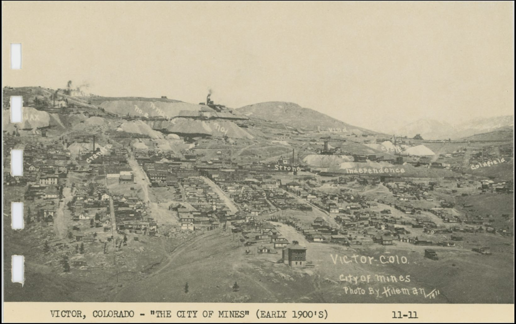 This view of Victor is looking north from Straub Mountain area. Photographed in 1911 by the Hileman as the view is credited to. Being this is from a printed card in a small more modern postcard folder it is not the greatest quality, but one gets an idea of the town and the many mines in and around it. In addition, in this view they are marked out, even if there is at least one error in that marking. * In upper left quadrangle is the Portland No. 1 & No. 2 marked out, but the location of the No. 2 shaft of the Portland is NOT where this image gives it! Portland No. 2 shaft is in this view above the No. 1 shaft, seen a little left of the center of this view sideways. No. 2 Shaft of Portland is seen against the sky with No. 1 just below it, with the huge dumps where No.1 is written. The Granite, original shaft, is located where this card has written the No.2 text. * Just behind and left of the huge smokestack of the Gold Coin shaft, marked in this view as Granite, is the main shaft of the Dead Pine. The dump is much easier seen then the mine itself.
