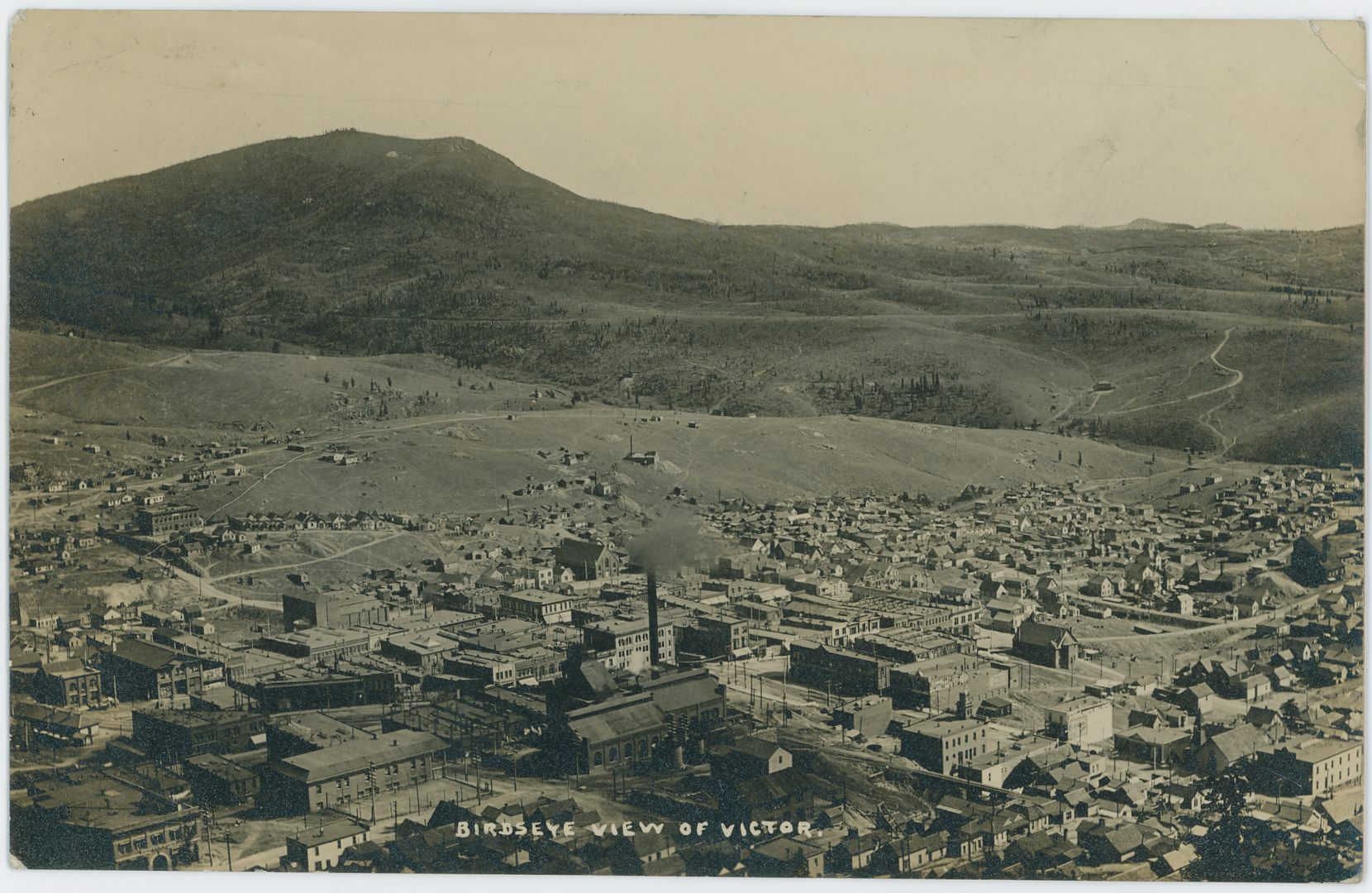 As the postcard is dated July 13, 1908 on the backside this photograph must be older than that date... Sadly the image itself is rather dark and while it is a photo type of card, it has lots of reflections to it and is hard to clean up. The view itself is yet another view of the town of Victor from up on Squaw Mountain, this time the Gold Coin mine is not as centered as it often was. Off to the right hand-hand side, a little further up then 1/3 from the bottom, is the largest edition of the Shaft House of the St. Patrick mine that I have seen, with a growing dump north of it, which will say to the left.