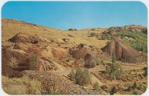 "Great slopes filled with old mines and mine dumps at Cripple Creek, Colorado. ""The World's Greatest Gold Camp."""