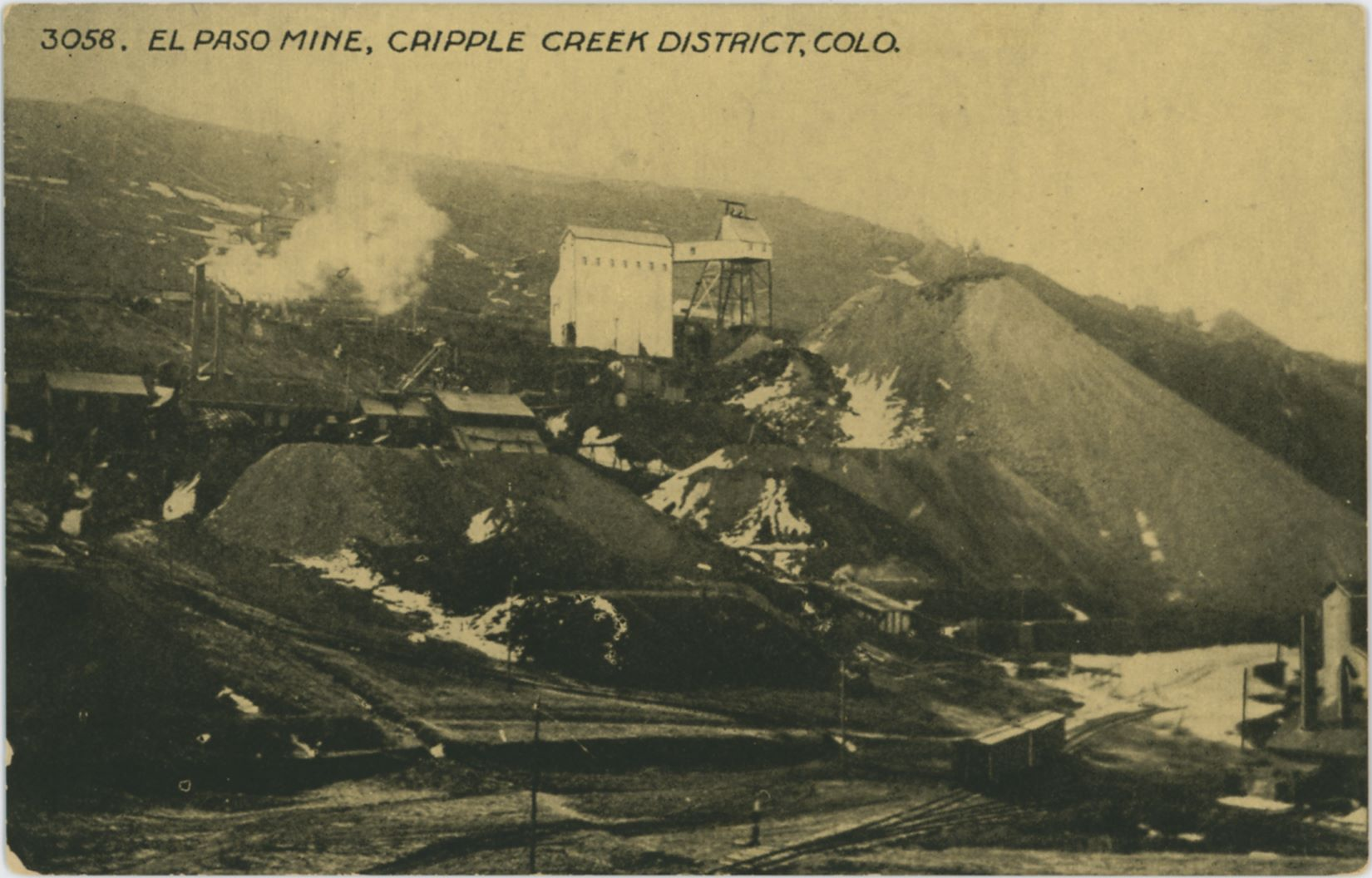 This image is a good one, in spite of the quality being too dark and that it sadly is of the printed type. But, the scene it shows makes it great as it shows the short-lived Switchback branch of the Florence & Cripple Creek that went down Beacon Hill to the Henry Adney & Old Gold mines in the valley below the impressive El Paso Mine, seen with its light colored large ore house and partly built in head frame about 1/3 from top at center of image.    A little below that at left is the C.K. & N. Mine, seen about middle top/down and in lower right-hand corner is the Henry Adney mine with a couple of F. & C.C. boxcars standing on the track nearby.