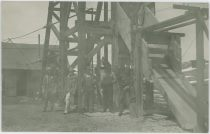 Group of Unknown Miners Posing at the Headframe of the Cameron Mine