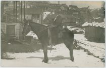 A View at a Boy-Scout/Man on a Horse on Hillside Near Eastern End of Spicer Avenue, with Houses, High School, Mines in the Background