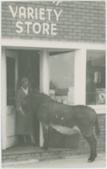 Donkey in Doorway with Lady, Structure is Marked 'Variety Store' Above the Doorway